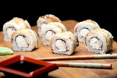Dragon sushi roll with eel and cream cheese. Stock Images