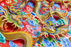 The Dragon. Is the symbol of power. Generality any kind of art decorated in Buddhist church, temple pavilion, temple hall, monk's house etc. created with money Stock Image