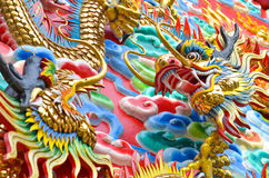 Dragon. The Dragon is the symbol of power. Generality any kind of art decorated in Buddhist church, temple pavilion, temple hall, monk's house etc. created with Stock Photography
