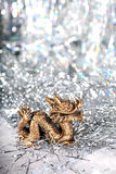 Dragon symbol of the year 2012. On a bright background bokeh Royalty Free Stock Photos
