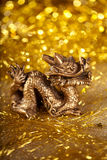 Dragon symbol of the year 2012. On a bright background bokeh Royalty Free Stock Images
