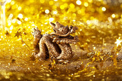 Dragon symbol of the year 2012. On a bright background bokeh Stock Image