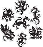 Dragon symbols. Series of medieval-styled dragon symbols Stock Photos