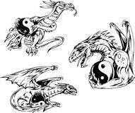 Dragon tattoos with yin-yang signs Stock Photo