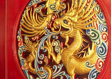Dragon temple. Chinese dragon statue on the wall background royalty free stock photo