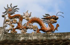 Dragon on a temple roof. Dragon on a roof of a Vietnamese temple royalty free stock photos