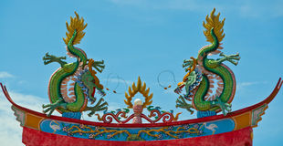 Dragon on top of temple roof Royalty Free Stock Images