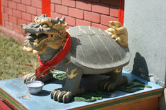Dragon tortoise. One of the mythical Chinese celestial creatures, standing guard at the entrance of a Chinese temple Stock Photos