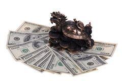 Dragon-turtle on hundred dollar bills Stock Photos