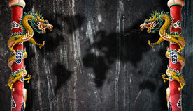 Dragon. Twin dragon pillar black background world map Royalty Free Stock Image