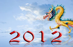 Dragon walking with 2012 year number on the sky. Dragon walking with 2012 year numbe, New year greeting card background Royalty Free Stock Photo
