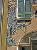 Dragon on the wall. Dragon detail on building in art nouveau style stock photography