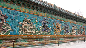 Dragon Wall. With 8 dragons carved. Each dragon has a different color. Ancient wall art found in Beijing China. Said to be 700 years old from the Ming Dynasty royalty free stock photography