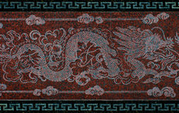 Dragon on wall in a Chinese temple. Thailand royalty free stock image