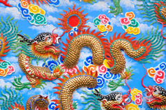The dragon on the wall. The golden dragon on the wall Royalty Free Stock Image