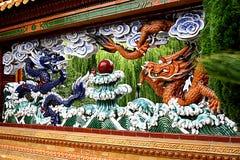 Dragon Wall i kinesisk kamratskapträdgård arkivbilder