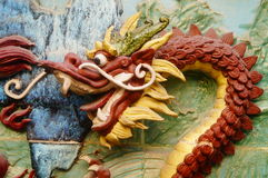 The dragon on the wall. Dragon statues on temple walls, lifelike. In Shenzhen, china Stock Photos