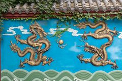 One of-Gilding dragon wall. Dragon Wall is a unique form of architecture in China. It has a dragon wall, three dragon walls, five dragon walls, seven dragon stock images
