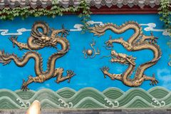 Three-Gilding dragon wall. Dragon Wall is a unique form of architecture in China. It has a dragon wall, three dragon walls, five dragon walls, seven dragon walls royalty free stock photo