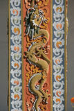 A dragon was sculptured on a pillar in the courtyard of a buddhist temple in Thimphu (Bhutan) Stock Photo