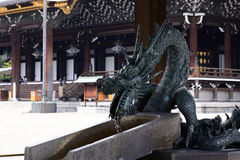 Dragon washbasin at Japanese temple Stock Photo