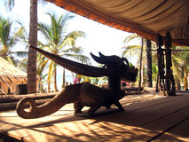Dragon Wood African sculpture Royalty Free Stock Image