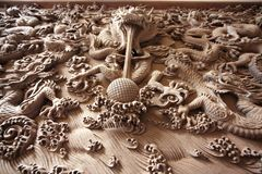 Dragon wood carve Stock Images