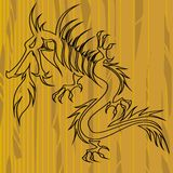Dragon on wood with copy space Royalty Free Stock Photos
