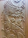 Dragon wooden carving wood Chinese year new sign symbols religion powers leader. Beautiful Wood carving dragon royalty free stock photos