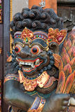 Dragon wooden sculpture on temple door in Bali, Indonesia Royalty Free Stock Images