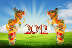 Dragon of year 2012 background with clipping path. Dragon of year 2012 with field and blue sky background with clipping path Royalty Free Stock Photos