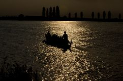 Dragonboat at sunset Stock Image