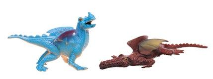 Dragones del juguete en fondo aislado blanco imagenes de archivo