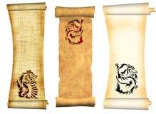Dragones. Desfiles de pergaminos viejos Imagen de archivo libre de regalías
