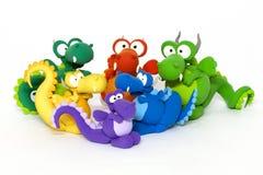 Dragones multicolores en blanco Imagen de archivo libre de regalías