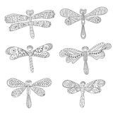 Dragonflies, abstract silhouettes on white Royalty Free Stock Photography