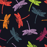 Dragonflies on a dark background Colorful seamless pattern. Dragonflies on a dark background Colorful pattern Royalty Free Stock Photos