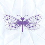 Dragonfly-blot on crumpled paper Royalty Free Stock Photo
