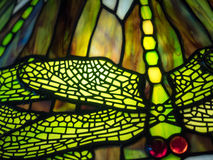 Dragonfly glass painting. On window stock photography