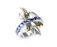 Dragonfly ring. 3d render of dragonfly ring of white and yellow gold and blue sapphires Royalty Free Stock Photography