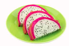 Dragonfruit. Pitaya - dragon fruit,slide dragon fruit on green dish Royalty Free Stock Images
