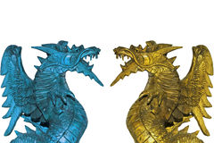 Dragons. Close-up of a two colored wood dragon statuette as background with copy space Royalty Free Stock Photos