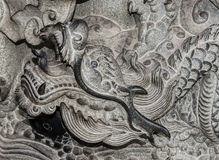 Dragons. Carvings on a stone column Stock Photo