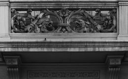 Dragons on the balcony. Shot in black and white. Placed on the facade of this historic building, sculpture  representing a pair of dragons. Set in Eixample Stock Photography