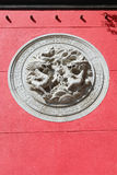 Dragons. Bas-relief on the wall of the temple Royalty Free Stock Image