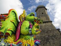 Dragons and Castles. A colourful dragon with a fortress in the background Royalty Free Stock Photos