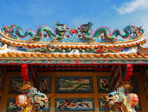 Dragons on a Chinese shrine roof Royalty Free Stock Photo