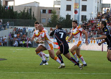 Dragons de Catalans contre des guerriers de Wigan photos libres de droits