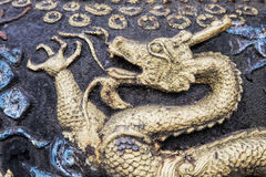 Dragons that decorate the Qingyang Temple in Chengdu, China. Close up details of the many dragons that decorate the Qingyang Temple in Chengdu, Sichuan province stock photos