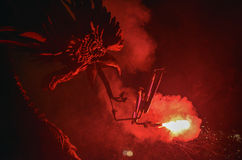 Dragons and devils armed with fireworks dance. Royalty Free Stock Photography